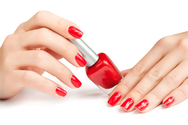 A Nail Polish And A Pair of Hands with Red Nail Polish on the Nails